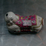 chinese or budda figuine lying down unknown maker porcelain @sold@